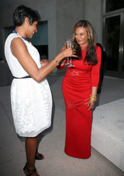 EBONY Editor-in-Chief Kierna Mayo toasts with Tina Knowles on a successful (and sexy) cover.