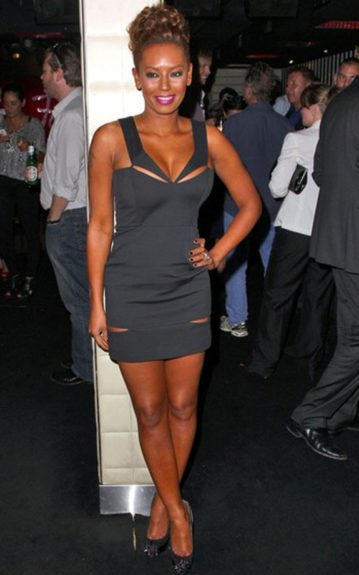 Melanie Brown in a sexy LBD with cutouts that flaunt some skin—tastefully