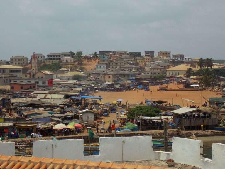 The view from Elmina right outside the castle shows that no matter the size of the atrocity, life goes on.