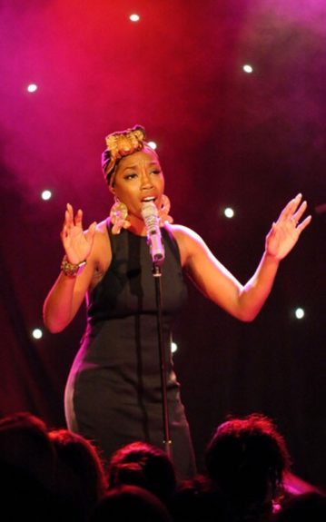 Estelle couples her LBD with a gorgeous turban, a pair of statement ribbon earrings and a matte, red mouth