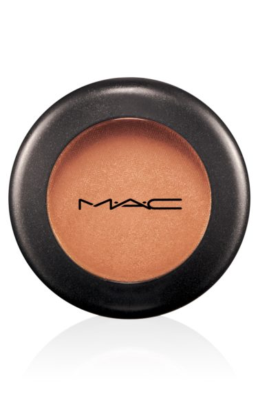 "Orange eye shadow was also a big hit on the catwalk. Test it out with this MAC Amber Lights eye shadow that's a peachy-brown with a shimmer. $15 at <a href=""http://www.maccosmetics.com/product/shaded/154/363/Products/Eyes/Shadow/Eye-Shadow/index.tmpl"">www.maccosmetics.com</a>."