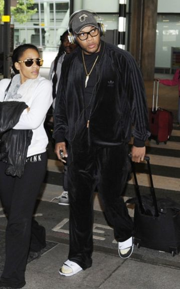 FloRida and Melyssa are airport ready. He wears a black velour jogging suit, while she wears black Victoria Secret Pink sweatpants, and white jacket.