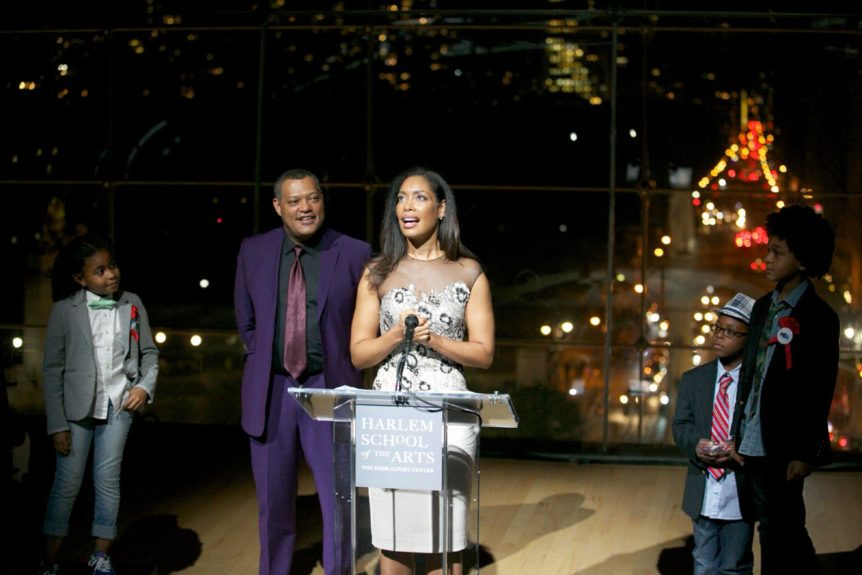 Laurence Fishburneand wife Gina Torres accept the Visionary Artist Award at the Harlem School of the Arts.