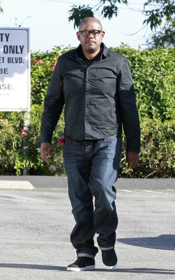 Forest Whitaker took a stroll in a black button-down shirt, jeans and black and white sneakers.
