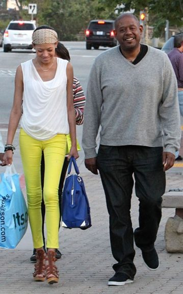 Forest Whittaker and wife, Keisha took a stroll; Forest in a grey sweater with black jeans and sneakers and a very thin Keshia in bright yellow jeans with a draped white tank and a printed head scarf