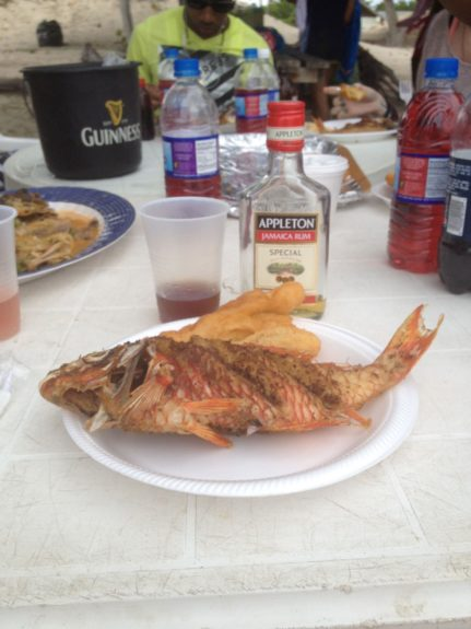 St. Clarence Beach feast: parrotfish, bammy and festival with Appleton-spiked Pepsi.