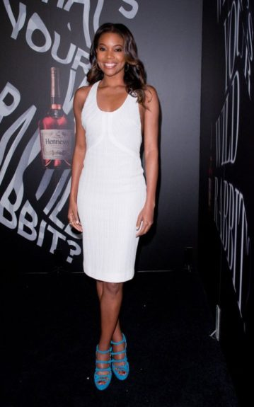 Gabrielle Union knows how to keep it simple yet trendy. She looked fresh and fun in this white tank dress and electric blue strappy platform sandals.