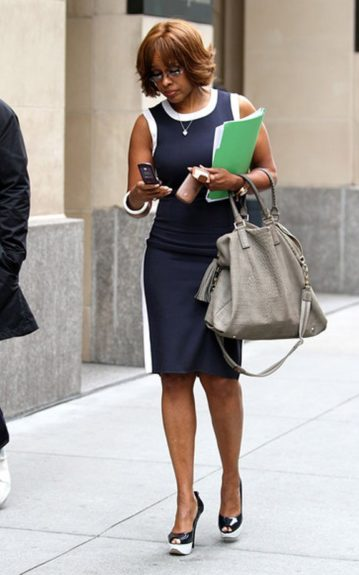 Gayle King works while she walks in a pencil dress with a sporty feel and matching navy blue and white pep-toe pumps