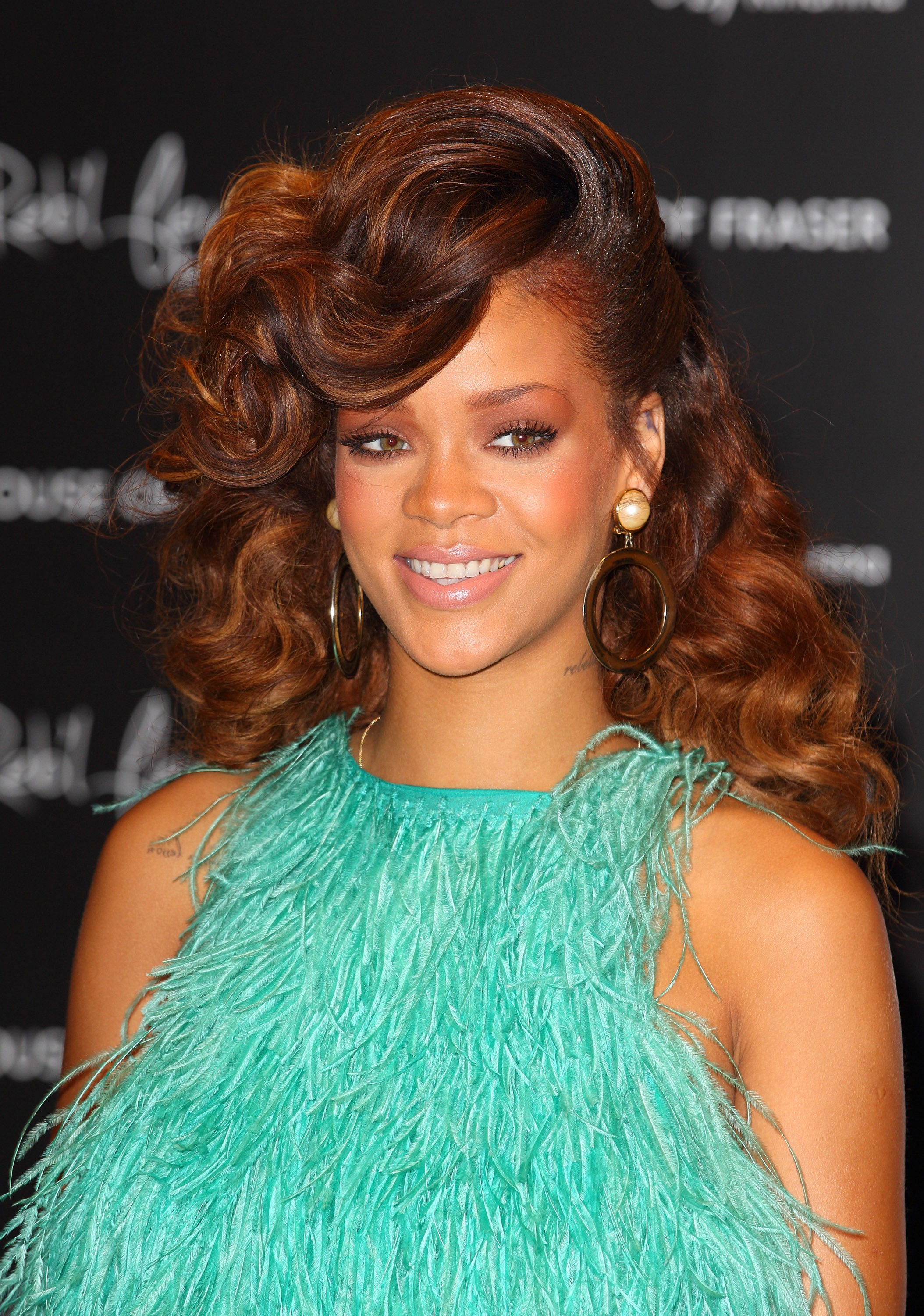 Back to basics, Rihanna reclaims her femininity, and lays rest to her hard edgy signature. She's free and flirty in this retro look.