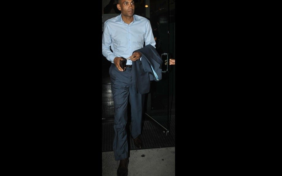 Grant Hill wears a light blue button down, and a navy blue suit