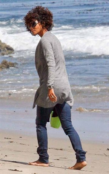 Halle's curls are gone with the wind as she takes a stroll on the beach in Malibu, CA
