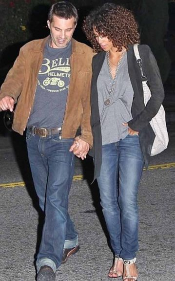 Here, the color of Halle's ombre locks are more noticeable than ever as her tresses shield her face as she walks hand-in-hand with her fiancé