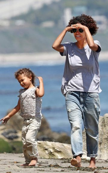 Halle Berry and daughter, Nahla, spend some quality family time on the beach comfortably in cuffed boyfriend jeans and loose-fitting tops
