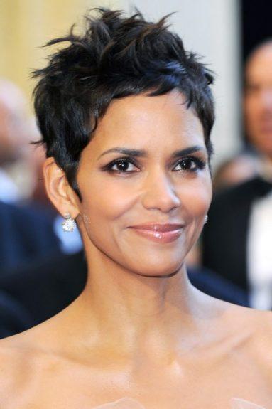 <strong>The Pixie Cut:</strong> Dab some wax on your finger tips and run through you hair, shaping small sections upward.