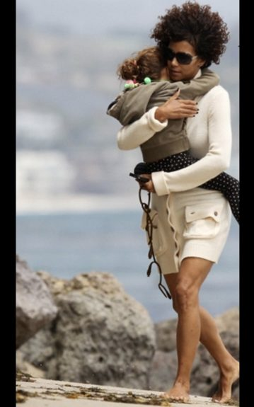 Halle Berry and Nahla are always picture perfect. Halle in her tan long-sleeved sweater dress, carried her tired daughter.