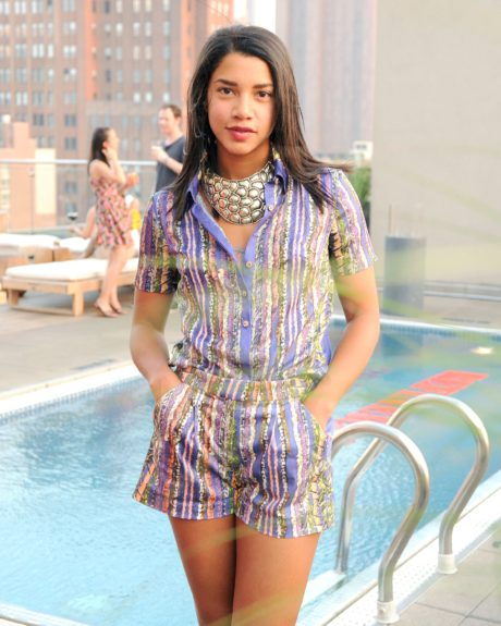 Poolside, Bronfman dons a vintage inspired romper with a bold necklace