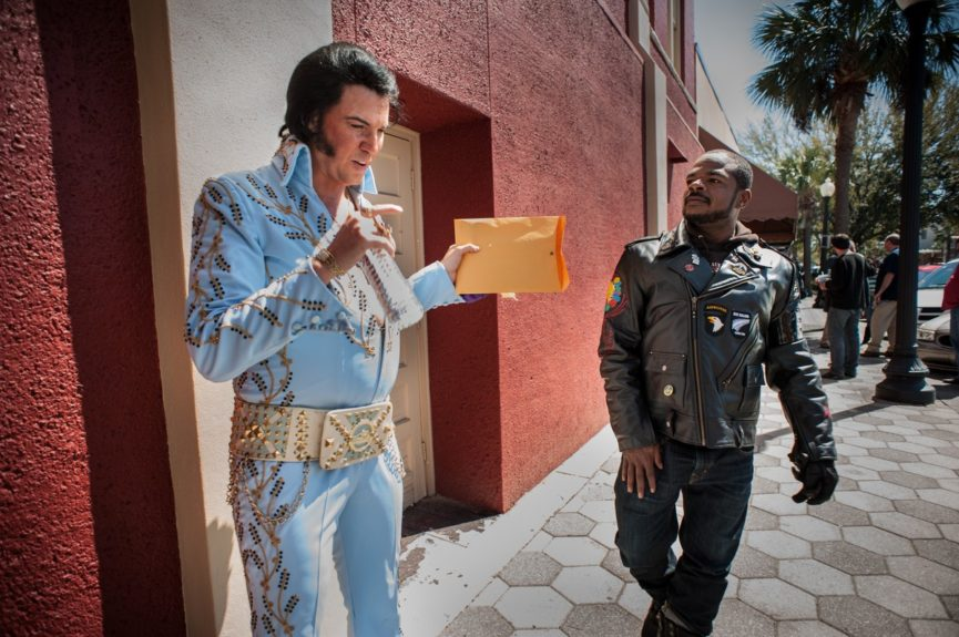 """F. Gary Gray approaches Elvis impersonator William Stiles, of Memphis. """"Every time you get on the bike, you never experience the exact same thing, and that's what's really cool about it. We just ran into an Elvis festival just going to lunch. You're not gonna get that in LA."""