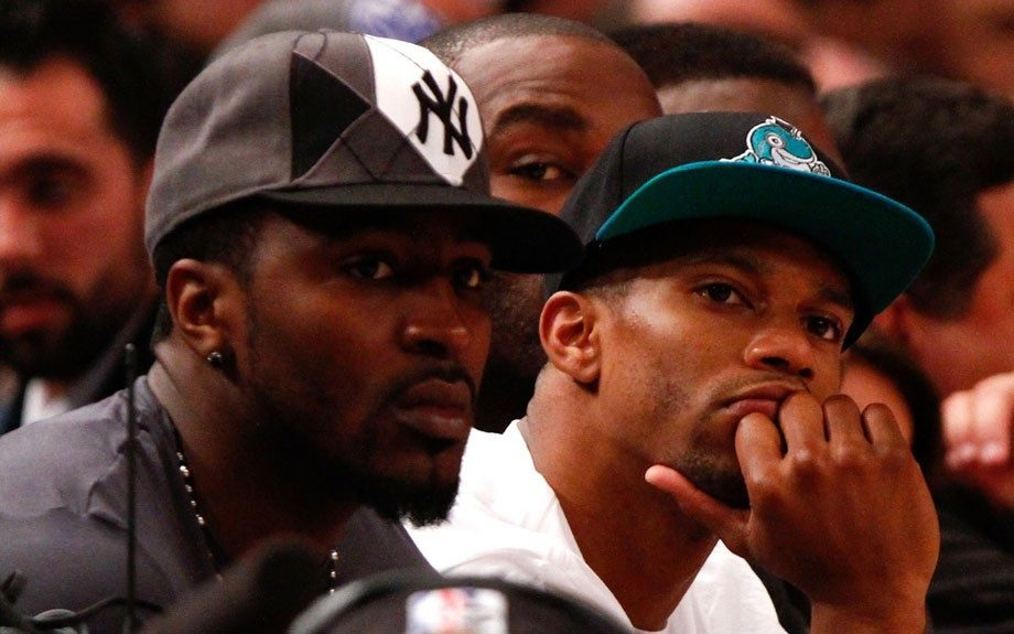 Hakeem Knicks and Victor Cruz watch the Knicks play the Heat for game four of the quarterfinals of the NBA Playoffs; Hakeem in a grey black and white argyle Yankee fitted