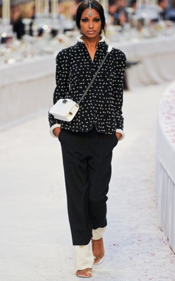 Jasmine Tookes struts down the Chanel runway in a beautiful headpiece that runs along her low ponytail's middle part