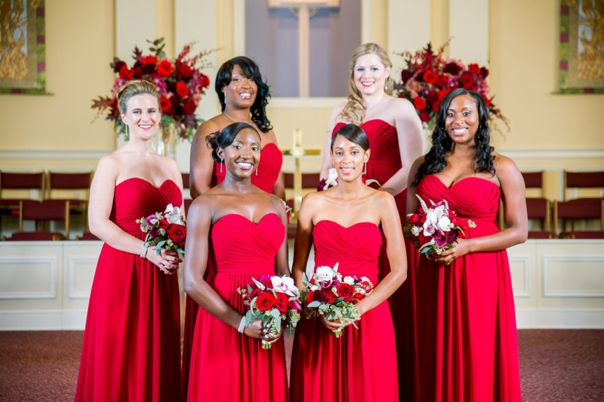 The bridesmaids made a statement in their spicy red gowns.