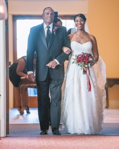 Here comes the bride with her dapper father.
