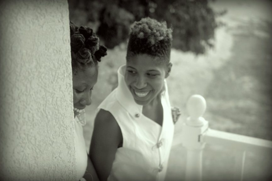 Dr. Emma Benn smiles at her brides Nicole Y. Dennis before making history