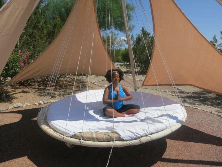 Me meditating on the floating bed.