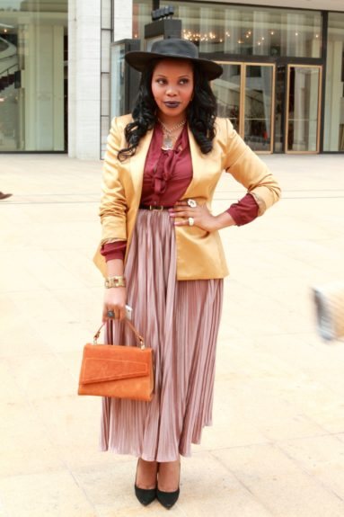 Tosun Oju demonstrated how fabulous fast fashion could be, in a skirt from The Limited with a jacket and top from American Apparel. She set it off with vintage accessories.
