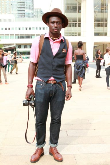 Steven Onoja sets the standard for menswear in Timberland boots, J Crew pants, and a Marc Jacobs vest.