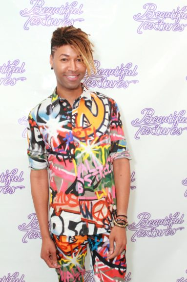 Beyonce's Stylist Ty Hunter rocked his locs and a killer graffiti print suit.