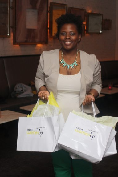 EBONY.com intern Sylvia Obell delivering Women Up goodie bags