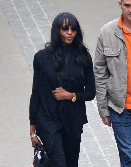 March 28, 2012: Naomi Campbell goes to pray in the Chapel of the Miraculous Medal in Paris before taking a flight at Roissy, France.