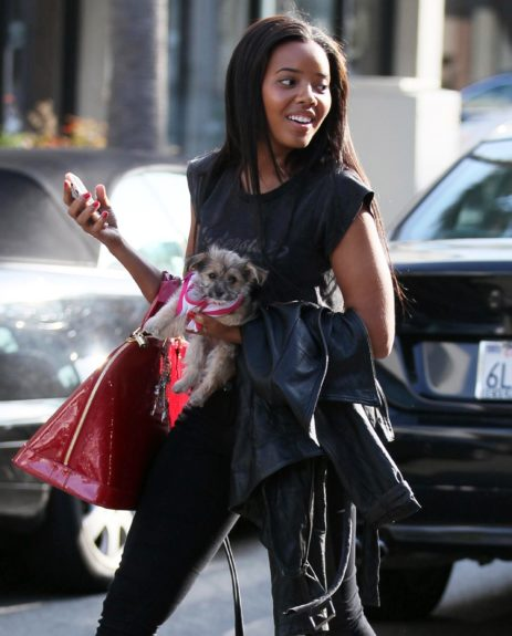 March 29, 2012: Angela Simmons pictured out running errands with her pet pooch in Beverly Hills, California.