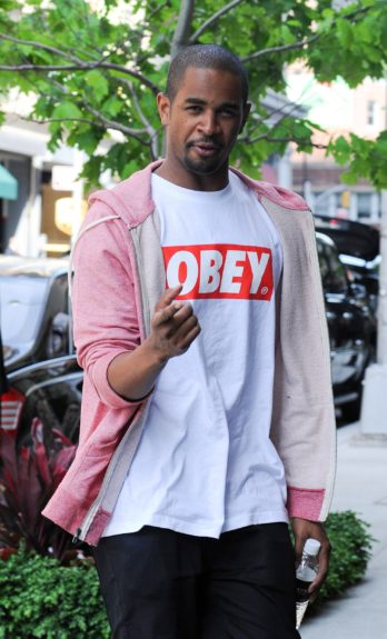 Damon Wayans Jr. is seen out in New York City wearing a pink hoodie.