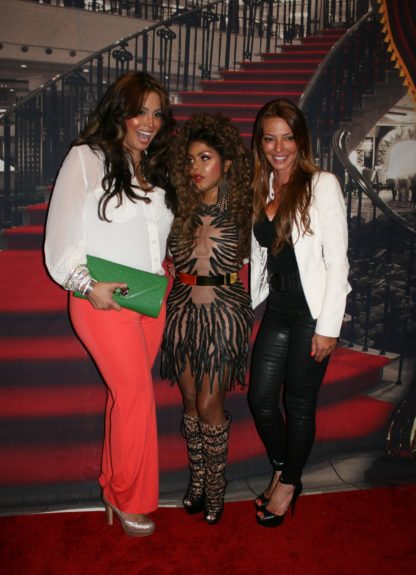 Somaya Reece, Lil Kim and Drita D'Avanzo arriving at the Paradise Theater in the Bronx borough of New York City.