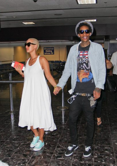 Amber Rose and Wiz Khalifa where spotted living Las Vegas Airport this afternoon walking hand in hand.