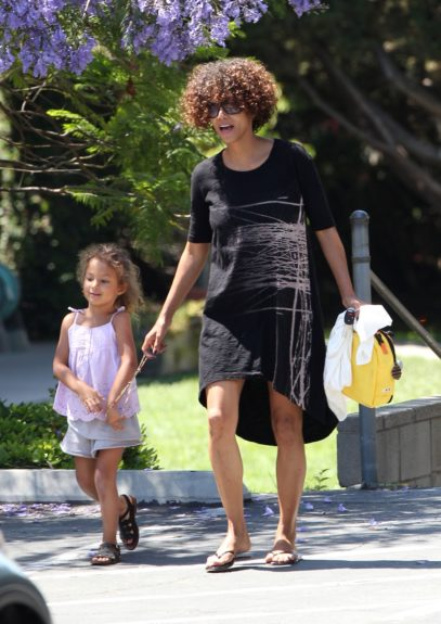 Halle Berry was seen picking up her daughter, Nahla Aubry at school this morning in Los Angeles, California. Nahla held a project called 'All About Nahla' about the child's life and family.