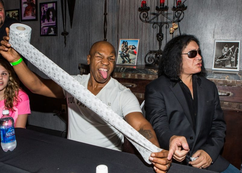 Mike Tyson and Gene Simmons pictured at KISS by Monster Mini Golf in Las Vegas, Nevada.