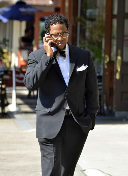 D.L. Hughley chats on the phone while out in New York City.