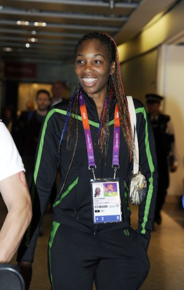 Venus Williams arriving at London's Heathrow Airport today sporting red, white, and blue braids in honor of the Olympics.