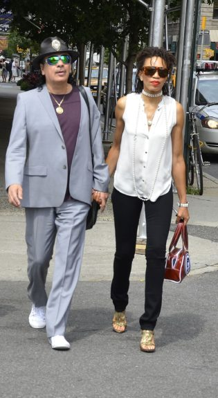 Carlos Santana takes a stroll with his wife Cindy Blackman in New York City.