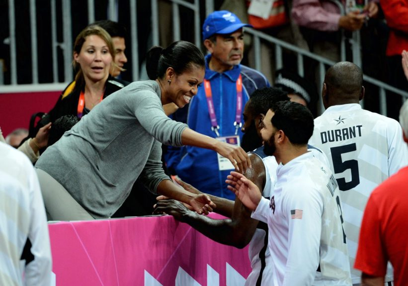 Michelle Obama greets James Harden during the London Olympics of USA Vs. France in the UK.