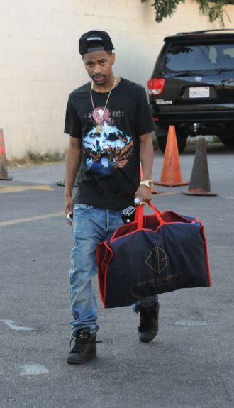 Big Sean spotted in West Hollwyood carrying an Opening Ceremony bag.