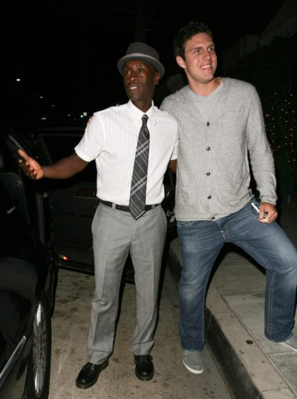Don Cheadle poses with fans after dining with his girlfriend Bridgid Coulter (not pictured) at Mr.Chow's in Beverly Hills, California.