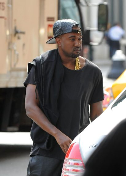 Kanye West is seen leaving his apartment early in the morning in New York City.