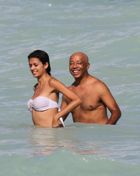 Media mogul Russell Simmons enjoys a romantic afternoon at the beach with new girlfriend Leila Lopes in Miami.