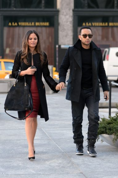 John Legend and his fiancee Chrissy Teigen were pictured leaving the NBC Studios and doing some shopping at the Apple Store in New York City.