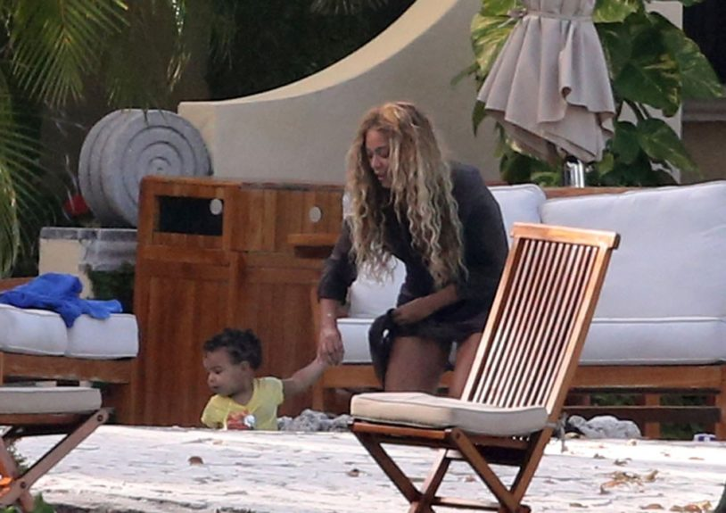 Beyoncé Knowles takes a day off from her busy tour schedule to spend time with friends and family by the pool in Miami Beach. Pictured here with daughter, Blue Ivy Carter.