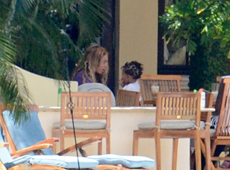 Beyoncé Knowles takes a day off from her busy tour schedule to spend time with friends and family by the pool in Miami Beach, Florida. Pictured here with daughter Blue Ivy Carter.