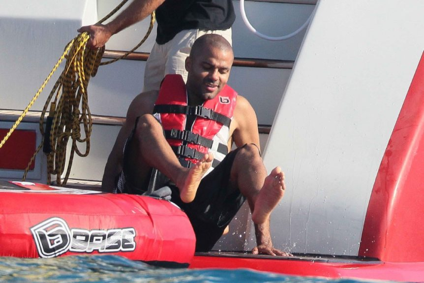 Tony Parker of the San Antonio Spurs, on holiday with female friends in Saint-Tropez, France.